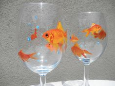 Hey, I found this really awesome Etsy listing at http://www.etsy.com/listing/130687219/hand-painted-goldfish-wine-glasses