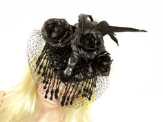 Handmade victorian Gothic fascinator with faux skull, feathers, pearls, hatnet and satin roses.  Available at my stores:  http://www.etsy.com/shop/NinielChan  www.deaddollsshop.de