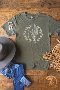 """- """"daydreamer"""" Graphic Tee - Ivory saguaro cactus and coyote with arrows graphic - Light olive green tri-blend soft t-shirt - Unisex sizing - Fit is true to a loose fitting women's t-shirt i. Cowgirl Outfits, Cowgirl Style, Western Outfits, Southern Outfits, Country Outfits, Western Chic, Western Wear, Estilo Country, Country Style"""