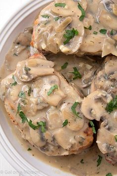 Pork Chops with Creamy Mushroom Sauce: So moist and baked to perfection with an out-of-this-world creamy sauce!
