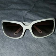 Gorgeous white nwot coach jeweled sunglasses New without tags. These glasses have never been worn and are in excellent condition. All jewels are firmly intact and shine pretty. No scratches that I can see if any kind. Very stylish. Perfect for summer. Authentic Coach. Feel free to ask questions : ) Coach Accessories Sunglasses