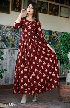 Gowns Partywear Rayon Printed Women's Gown Fabric: Rayon Sleeves: Sleeves Are Included  Size:  M - 38 in L - 40 in XL - 42 in XXL - 44 in  Length: Up To 53 in Type: Stitched Description: It Has 1 Piece Of Women's Gown  Work: Printed Country of Origin: India Sizes Available: M, L, XL, XXL, XXXL   Catalog Rating: ★4.3 (426)  Catalog Name: Pihu Partywear Rayon Printed Women's Gowns Vol 5 CatalogID_381961 C79-SC1289 Code: 415-2813670-