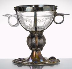 "Two-hadled cup, known as the ""Henry Chalice"" Tradition holds that it was a consecration gift to the Alte Kapelle from Henry II, the last Holy Roman Emperor from the Ottonian dynasty, who died in 1024 and was later canonised. (rock crystal, silver-gilt, precious stones; height 13 cm); crystal: Fatimid, around 1000; mount: probably German, twelfth century"