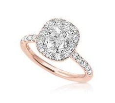 I looooooove rose gold for wedding rings... How beautiful & unique! Not so much the oval cut diamond...