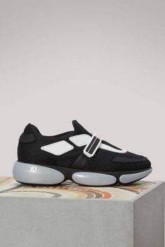 Prada Cloud bust sneakers. Very unique black and white gym shoes/sneakers from Prada. #ad