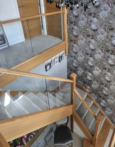 We used a modern mix of glass and natural oak with carpeted treads that sweep…