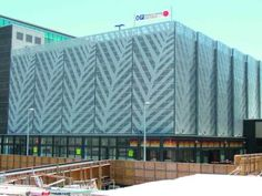 Perforated metal or wire mesh provides light and airflow while giving a building privacy Wire Mesh, Metal Mesh, Facade Pattern, Perforated Metal, Glass Facades, Metal Walls, Pavilion, Lockers, Architecture Design