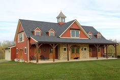 A beautiful custom-built timber frame hybrid home designed to resemble a barn
