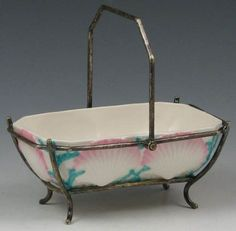 An Irish Belleek, Porcelain SHell Bowl with Pink and BlueColor inSterling Silver Basket. Circa 1863-1890