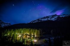 Banff National Park is known world wide. One of the many places to stay is the Morraine Lake Lodge. During a long night of shooting star activity over the Lake I took this image  to check if there was any sign of the foretasted northern light activity. You can see a slight purple glow over the mountain range while looking west. To the north it was far to cloudy.