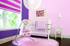 Get baby excited for every day in this brightly colored nursery. #Baby #Girl #FisherPrice #Cradle&Swing