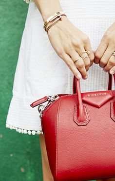 Turn heads with this beautiful deep-red Givenchy bag that complements white perfectly.