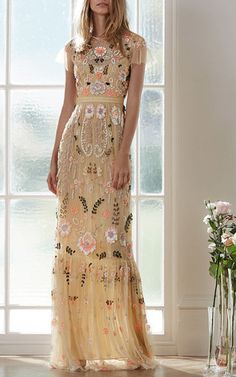 This **Needle & Thread** dress is rendered in sheer tulle with floral embroidery throughout and features a jewel neckline with short ruffle sleeves, a fitted waist, and a floor length column skirt with a gathered hem. #LOVE