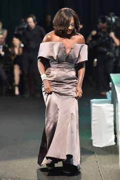 Here she comes! Viola Davis approached the stage a little more sedately than did Elba in h...