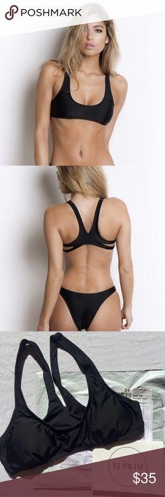 Mila Black Bikini Top Sporty yet sexy black bikini top from TJ SWIM in Australia. Padded cups fits A-B bra sizes. Perfect little black bikini! Never worn, originally priced at $40 + $25 shipping from Aus. *tagged for exposure Frankie's Bikinis Swim Bikinis