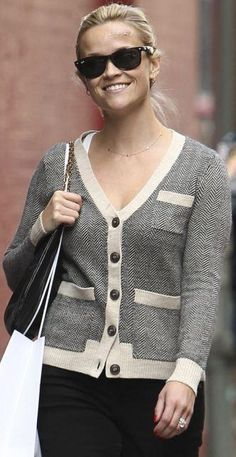 Who made Reese Witherspoon's gray cardigan and black sunglasses? Sweater – Madewell Sunglasses – Ray Ban