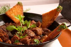 Photo about Hearty boar stew served in a small pan. Image of herbs, table, thyme - 14402152 Dutch Recipes, Greek Recipes, Mets, I Love Food, Cornbread, Tapas, Slow Cooker, Food And Drink, Yummy Food