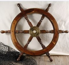 "24"" Wood and Brass Ships Wheel $40; for Pirate portion of Neverland room."