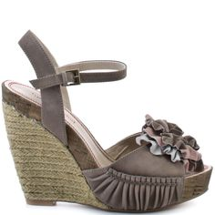 You don't have to wait for spring for the flowers to bloom in this pretty style from Luxury Rebel.  Tara is a 4 1/2 inch espadrille wedge with a light grey leather upper.  There is ruching detail at the sides of the vamp and a unique leather flower at the toe box.