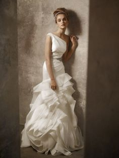 Daring and demure: Brides with one shoulder wedding dresses to die for