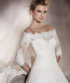 Pronovias > ALGECIRAS - Wedding dress in garza, lace and an off-the-shoulders neckline