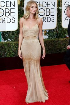 Rosie Huntington-Whiteley in an Atelier Versace custom gown and Giuseppe Zanotti sandals for the 73rd Golden Globe Awards held at the Beverly Hilton Hotel in Los Angeles on January 10, 2016.