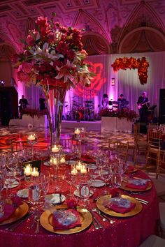 Stunning decor for a wedding in the Mediterranean Ballroom! All hot pinks & reds and sparkly linen...