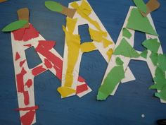 """After cutting out an """"A"""" shape out of heavy tag board, the children ripped up pieces of scrap papers to glue on. We were going to stop there, but then we thought they needed a stem and leaf! How perfect!! **Ripping/Tearing is an excellent activity for young children. It really helps develop the strength in their tiny hands."""
