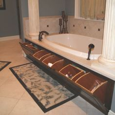 Master Bath Garden Tub: hidden storage - such a convenient place to the shampoo bottles & such! Love!