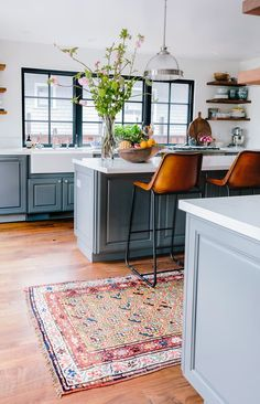 A rug is one of the quickest and easiest to make a more cozy kitchen. A vintage rug, like the one above from ABC Carpet & Home spotted on Honestly WTF, warms up a kitchen with texture and rich colors. Those buttery leather stools at the counter certainly don't hurt either.
