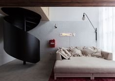 A jumble of wooden boxes provide a compact storage solution in this São Paulo micro apartment