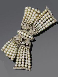 Platinum, pearl and diamond bow brooch, circa 1900.