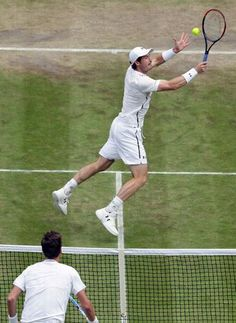 Andy Murray of Britain returns to Tomas Berdych of the Czech Republic during their men's semifinal singles match on day twelve of the Wimbledon Tennis Championships in London, Friday, July 8, 2016. (AP Photo/Tim Ireland)