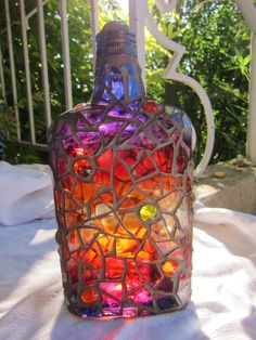 Frances Green - Painted Mosaic Bottle clear glass bottle painted w/glass paint in sunset colors with clear glass shards and dark gray grout. Mosaic Crafts, Mosaic Projects, Mosaic Art, Mosaic Glass, Glass Art, Clear Glass, Stained Glass, Mosaic Bottles, Painted Glass Bottles