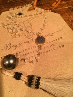 Moonstone rosary inspired necklace with hand tied horse hair tassel, large beautiful genuine black pearl with druzy connector with soft deer leather