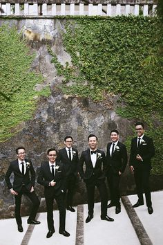 Groom and groomsmen looking smart in black // Audwin And Clarissa's Luminous Courtyard Wedding at Amanusa, Bali