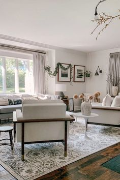 Combine elements of nature with muted gray tones to achieve a boho chic feel. Get the look at Barn & Willow. Boho Chic Living Room, Grey Interior Design, Drapery Rods, Custom Window Treatments, Window Frames, Living Room Inspiration, Flat Sheets, Window Coverings, Barn