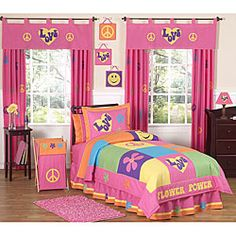 Vibrant hues and groovy prints style this quilt set for girls. The JoJo Designs bedding uses cotton in shades of pink, yellow, orange, turquoise and purple.