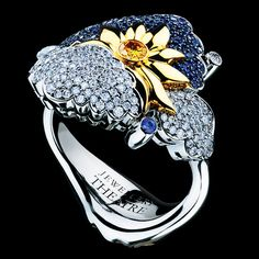 CLOUDS RING  18K white gold  167 diamonds 0,60-0,62 ct  1 yellow diamond 0,01-0,02 ct  135 blue sapphires 0,45-0,48 ct