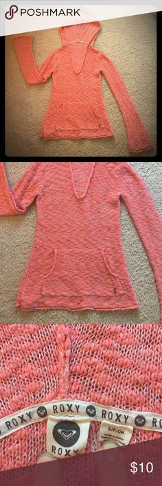 Roxy coral hooded pullover sweater shirt top S This is a coral pinkish orange colored pullover hooded sweater shirt top by Roxy in size small. It is in good used condition! Thanks for looking!!! Roxy Sweaters V-Necks