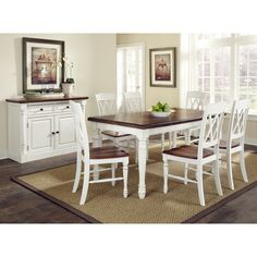 Add a stylish touch to your kitchen with this rectangular dining table. An 18-inch removable leaf and six chairs finish this dining set.