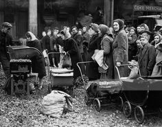 Housewives with their prams ready to take away the week's coal supply at the Nine Elms depot of the Gas Light and Coke Company in London. People are having to queue all day for their coal due to a fuel shortage. Gas Lights, London Street, Prams, Housewife, London People, Nostalgia, The Past, Strollers
