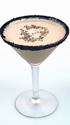 Ingredients: 2 oz Van Gogh Dutch Chocolate Vodka 1 oz Hazelnut Liqueur 1/2 oz Crème de Cacao Splash of Cream 2 Chocolate cookie wafers Directions: Rim a martini glass with crushed up chocolate cookie crumbs and set aside. Shake Van Gogh Dutch Chocolate Vodka, hazelnut liqueur, Crème de Cacao and cream over ice and pour into the martini glass. Dust top with more chocolate cookie crumbs.