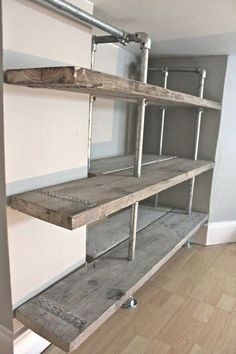 Whether you're going for a sophisticated, modern vibe or a homey, rustic appeal, industrial pipe shelves can be one way to accomplish both of these desired looks. Many people decide to build their own industrial pipe shelves that incorporate these aesthet Industrial Pipe Shelves, Metal Shelves, Wall Shelves, Pipe Shelving, Industrial Style, Rustic Shelving, Cheap Shelves, Industrial Shop, Industrial Lamps