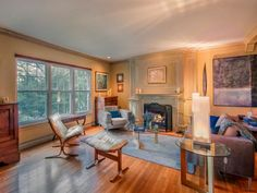 The fireplace is the anchor to this tranquil room. 1207 Merrimon Ave. Asheville, NC 28804 - Beverly-Hanks & Associates REALTORS®