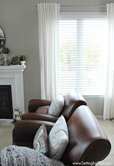 Family Room window treatment makeover with GORGEOUS horizontal blinds with double bevel edge that give the classic look of shutters without the pricetag!