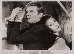 Roger Moore wears a Rolex Submariner 5513
