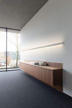 Check out www.supermodular.com for high-end architectural lighting fixtures and profiles.