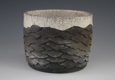 These pieces are made and trimmed on the pottery wheel. They are then hand  carved or etched and fired using either tradtional or resist raku methods.