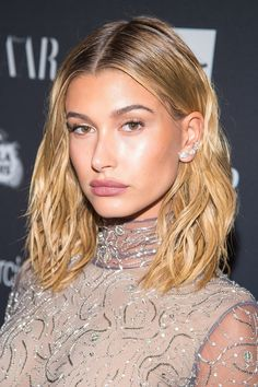 Blush doesn't have to be a rosy shade to look amazing. Hailey's tangerine cheeks beautifully offset the natural tint of her lipstick. A dollop of gel gives her freshly chopped waves extra definition.